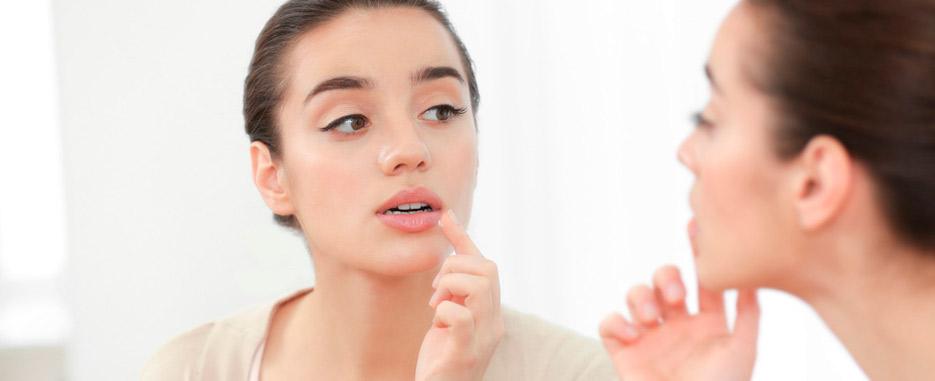 cual es la causa de las llagas en la boca
